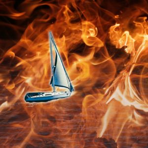 Stylized image of a silver sailboat sailing through a sea of flames