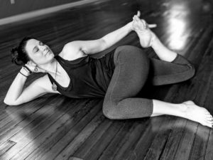 Machelle Lee woman laying on floor in yoga pose