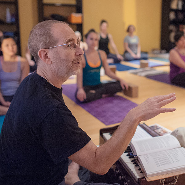 Hari-kirtana das teaching yoga